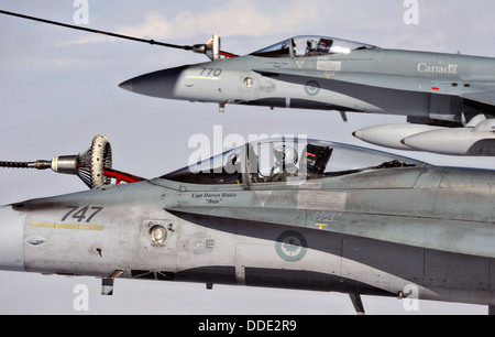 Royal Canadian Air Force CF-18 Hornet fighter aircraft assigned to the 409 Tactical Fighter Squadron refuel during - Stock Photo