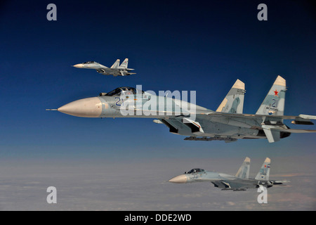 Russian Federation Air Force Su-27 fighter aircraft intercept a simulated hijacked aircraft during Exercise Vigilant - Stock Photo