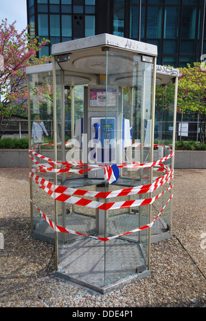 closed public phone box La Defense Paris France - Stock Photo