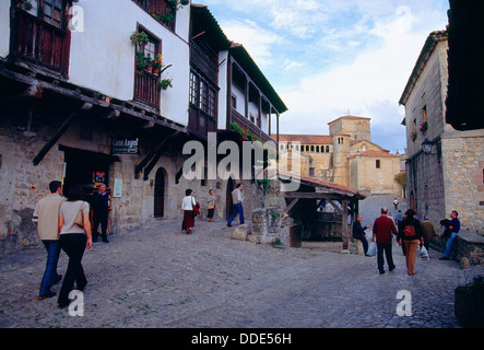 People walking along the street. Santillana del Mar, Cantabria, Spain. - Stock Photo