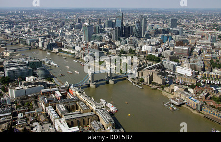 aerial view of The River Thames, Tower Bridge and City of London business area - Stock Photo