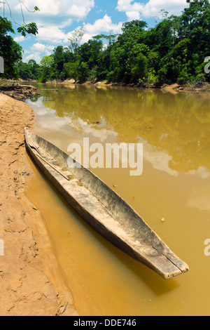 Dugout canoe beside the Rio Cononaco in the Ecuadorian Amazon - Stock Photo