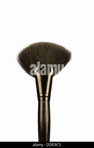 An image of a black make-up brush shot against a white background - Stock Photo