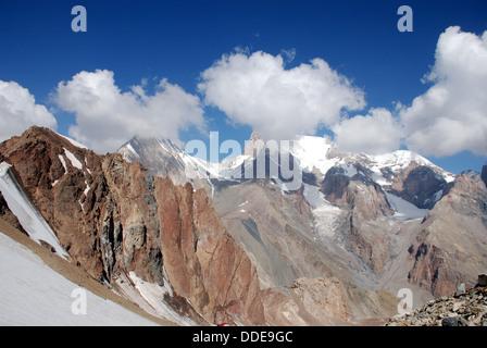 high cloud shrouded peaks in the Fann mountains of Tajikistan - Stock Photo