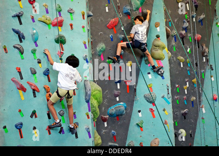 rock climbing at Brooklyn Boulders in NYC - Stock Photo
