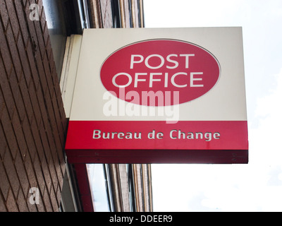 A Post Office and Bureau de Change sign on the side of a post office in the UK - Stock Photo