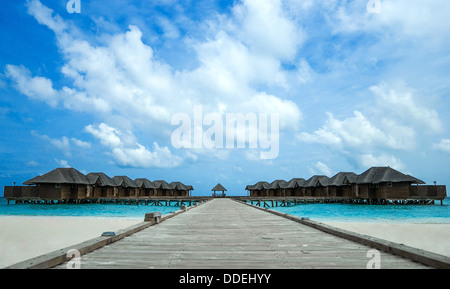 Island in the Ocean with houses - Stock Photo