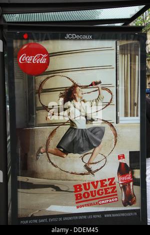 Coca Cola ad in Parisian bus stop, France - Stock Photo