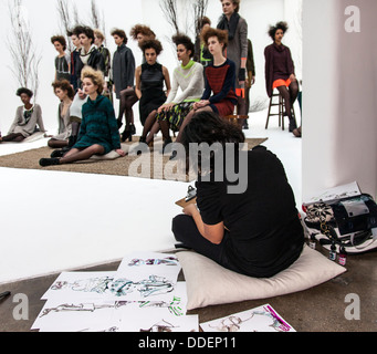 Fashion artist draws sketches for Ann Yee presentation of Fall/Winter 2013 collection at Go Studios during MBFW - Stock Photo