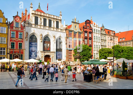 Tourists and Locals shopping and sightseeing in the historical old town at the port city of Danzig in Poland. - Stock Photo