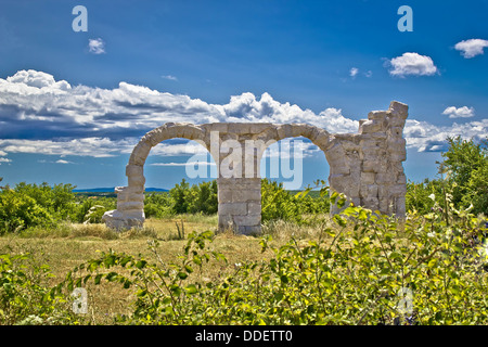 Ancient Roman Burnum archaeological site, remainf of a Roman Legion camp in Dalmatia, Croatia - Stock Photo