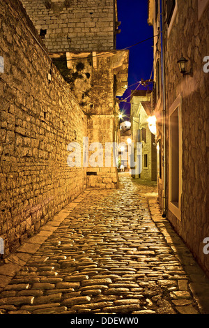 Narrow stone street in Vodice, Dalmatian architecture, Croatia - Stock Photo
