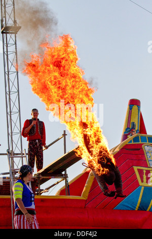 A burning stunt man dives into water during the 'Pirate Ship' children's play at the 2011 Kentucky state fair. Kentucky, - Stock Photo