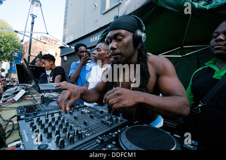 Disc jockey playing at open air concert during Notting Hill Festival - Stock Photo
