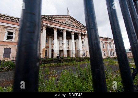The abandoned Crumlin road courthouse in West Belfast is protected by iron railings. It is an icon of the troubles. - Stock Photo