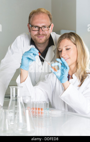 Portrait of young scientists working at the laboratory - Stock Photo