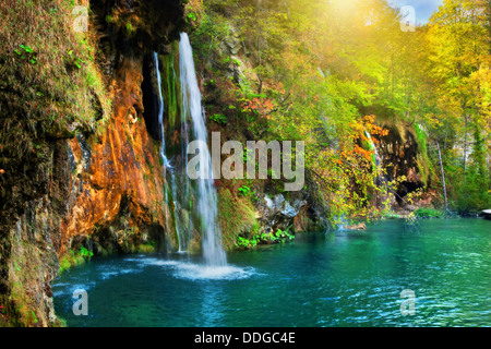 Waterfall in a forest in the Plitvice Lakes National Park, Croatia, Europe - Stock Photo