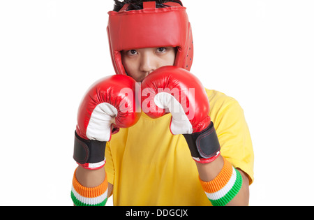 Portrait of boy wearing boxing gloves and head protector over white background - Stock Photo