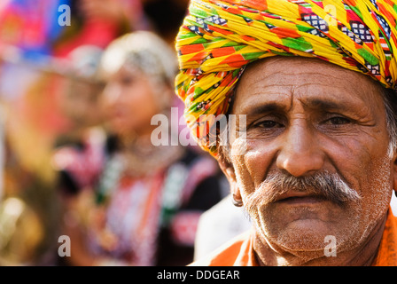 Portrait of a man in traditional Rajasthani dress at Surajkund Mela, Faridabad, Haryana, India - Stock Photo