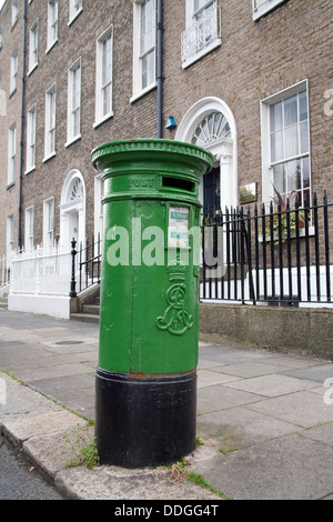 Green postbox in the Georgian streets of Dublin, Ireland - Stock Photo