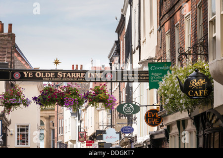 York - Stonegate and Ye Olde Starre Inne Sign - Stock Photo