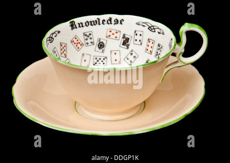 Vintage 'Cup of Knowledge' fortune telling cup and saucer by Aynsley Pottery. Design registered in 1923 (No 702537). - Stock Photo