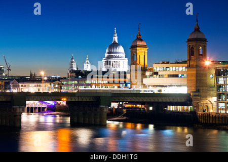 St. Pauls Cathedral Dome From London Bridge London UK - Stock Photo