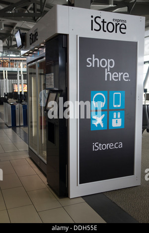 iStore Express vending machine at airport with Apple electronics and accessories - Stock Photo