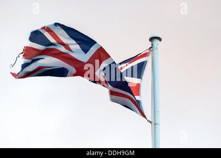 Union Jack Flag flying from a flagpole - Stock Photo