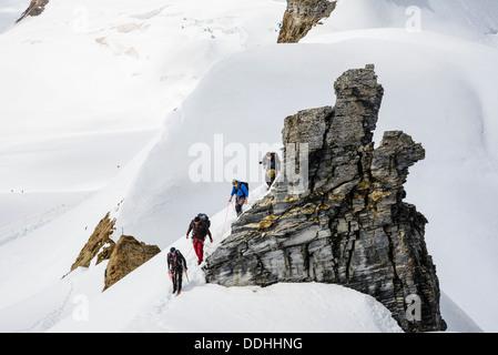 Climbers on the ridge of the Jungfraujoch, near Grindelwald Switzerland - Stock Photo