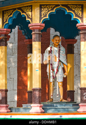 Representation of Mahatma Gandhi with walking stick in a small pavilion on the temple wall, Meenakshi Amman Temple - Stock Photo