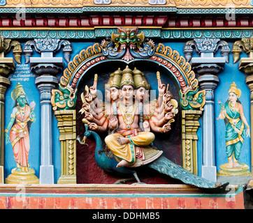 Hindu god Skanda or Murugan, also known as Karttikeya, Subramanya or Kumara with twelve arms and five heads on his - Stock Photo