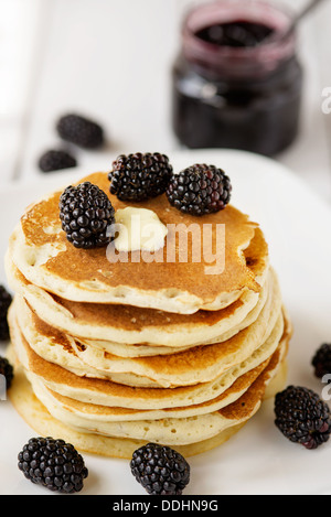 Stack of old-fashioned american pancakes with blackberry and maple syrup - Stock Photo