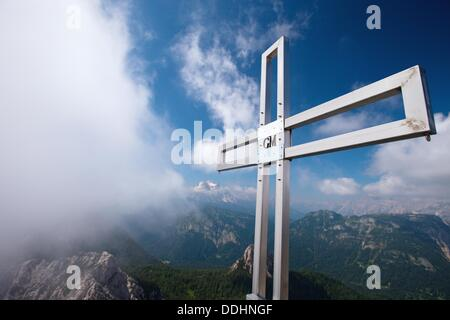 The cross at the base of the top of Sfornioi nord peak in the Belluno Dolomites, Unesco world natural heritage site, - Stock Photo