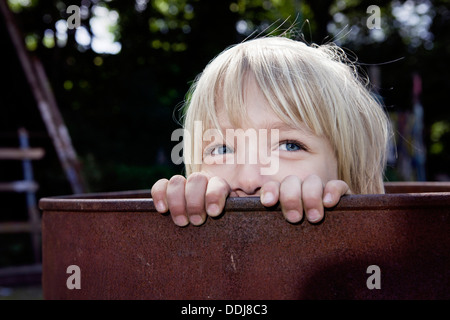 Germany, North Rhine Westphalia, Cologne,Boy playing with barrel, close up - Stock Photo