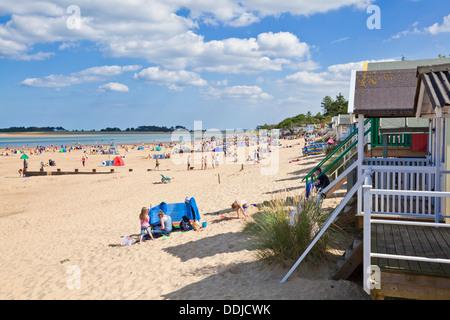 Busy Beach and beach huts at Wells next the sea North Norfolk coast England UK GB EU Europe - Stock Photo
