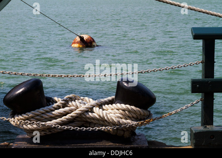 Bollard, rope, chain, and buoy seen from the Hyde Street pier in San Francisco Bay - Stock Photo