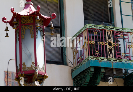 Traditional Chinese streetlight and decorated balcony in Chinatown, San Francisco - Stock Photo