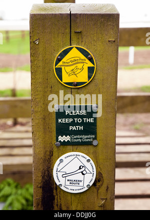 Walking route path signs on a post for the Icknield Way Trail and the Stour Valley Path, Dullingham, Cambridgeshire - Stock Photo