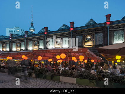 Berlin, hackesch market in summer, tourist magnet with cafes, restaurants, S-Bahn station, people - Stock Photo