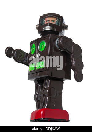 Vintage Toy Robot walking with green and red details - Stock Photo