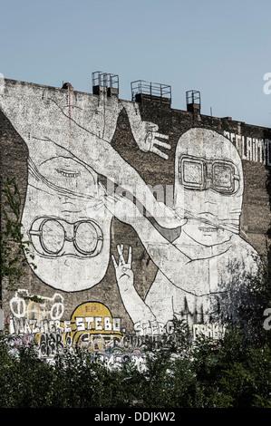 Mural on firewall in Kreuzberg by italian artist Blu , Berlin, Germany - Stock Photo
