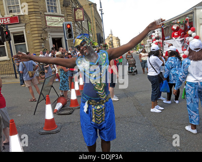 Costumed dancers from Huddersfield Carnival 2013 African Caribbean parade street party - Stock Photo