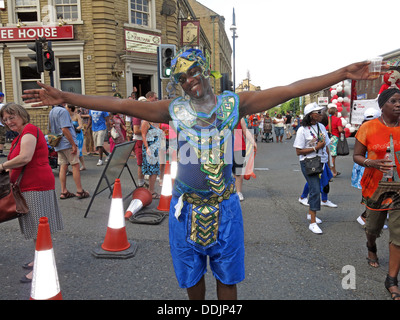 Costumed dancer in blue from Huddersfield Carnival 2013 African Caribbean parade street party - Stock Photo