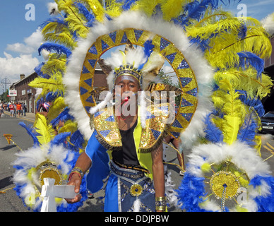 Costumed dancer in blue yellow from Huddersfield Carnival 2013 African Caribbean parade street party - Stock Photo