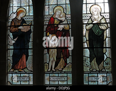 Patience Charity Humility Stained Glass in a church, South Window St Andrews Church Brympton D'Evercy Somerset England - Stock Photo