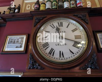 Potts Leeds clock at Dewsbury West Riding pub refreshment rooms, West Yorks, England, UK - Stock Photo