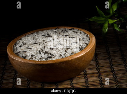 wild rice and the white rice in a wooden bowl - Stock Photo