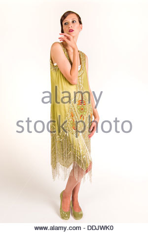 young woman in a 1920's flapper style dress and hair. - Stock Photo
