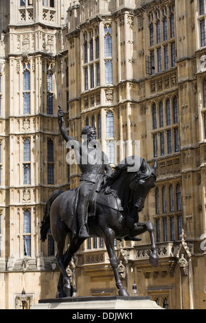 Richard the Lionheart statue outside the Houses of Parliament London - Stock Photo